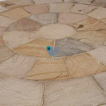 Autumn_brown_circle_sandstone_paving